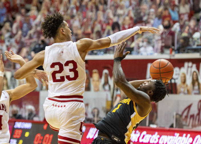 Indiana forward Trayce Jackson-Davis (23) blocks a shot by Iowa guard Joe Toussaint (1) during the first half of an NCAA college basketball game, Sunday, Feb. 7, 2021, in Bloomington, Ind. (AP Photo/Doug McSchooler)