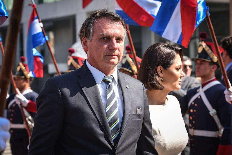 MONTEVIDEO, URUGUAY- (ARCHIVE): A file photo dated March 01, 2020 shows President of Brazil Jair Bolsonaro (L) along with his wife Michelle Bolsonaro (R) arriving at the inauguration ceremony of Uruguay's new President Luis Lacalle Pou, at the Plaza Independencia in Montevideo, Uruguay. President Jair Bolsonaro tested positive for coronavirus (COVID-19). (Photo by Carlos Lebrato/Anadolu Agency via Getty Images)