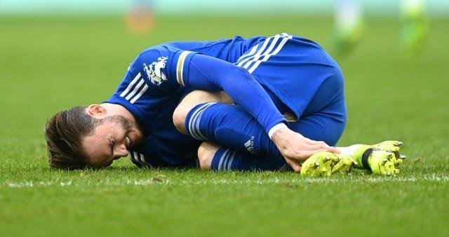 James Maddison clutches his ankle during Leicester's win against Aston Villa