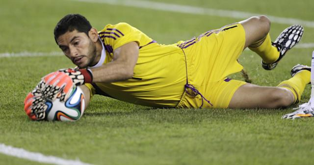 Mexico goalkeeper Jesus Corona saves a shot against Portugal during the first half of their friendly soccer match in Foxborough, Mass., Friday, June 6, 2014. (AP Photo/Charles Krupa)
