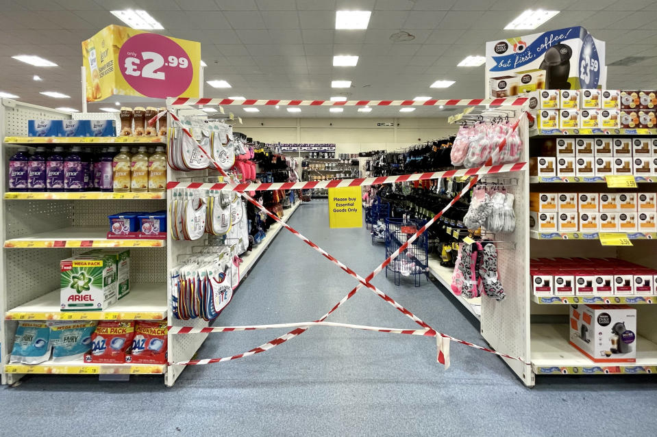 "CARDIFF, WALES - OCTOBER 27: Aisles blocked off in a B&M Bargains store on October 27, 2020, in Cardiff, Wales. The Welsh Government has issued an updated list of goods, which includes baby clothes, it said could be sold. It said people should also be able to ask for things not on the list ""by exception"". Pressure has mounted on the Welsh Government to reverse the decision to prohibit supermarkets from selling 'non-essential' items. (Photo by Matthew Horwood/Getty Images)"
