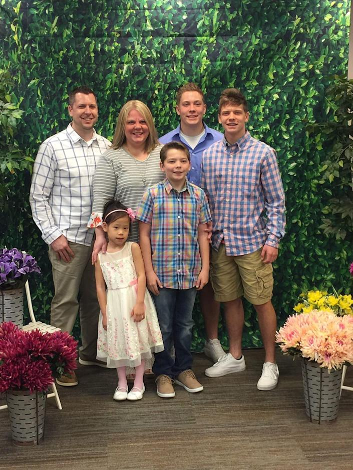 The Chandler family of Lowell, Ind. – clockwise from left, Jason, Beth, Sam, Jake, Colten and Cora – looks forward to adopting a girl from China, but the coronavirus outbreak has put an anxiety-inducing hold on the plan.