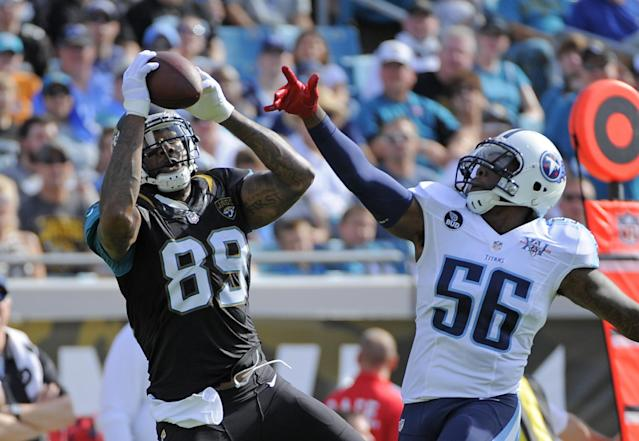 Jacksonville Jaguars tight end Marcedes Lewis (89) makes a reception in front of Tennessee Titans outside linebacker Akeem Ayers (56) during the first half of an NFL football game in Jacksonville, Fla., Sunday, Dec. 22, 2013. (AP Photo/Stephen Morton)