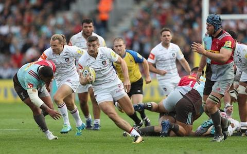 Jonny May, who scored Leicester's second try, races through the Harlequins defenceCredit: Getty Images