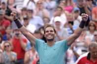 Spain's Rafael Nadal celebrates his win over Russia's Daniil Medvedev in the final of the Rogers Cup tennis tournament in Montreal, Sunday, Aug. 11, 2019. (Paul Chiasson/The Canadian Press via AP)