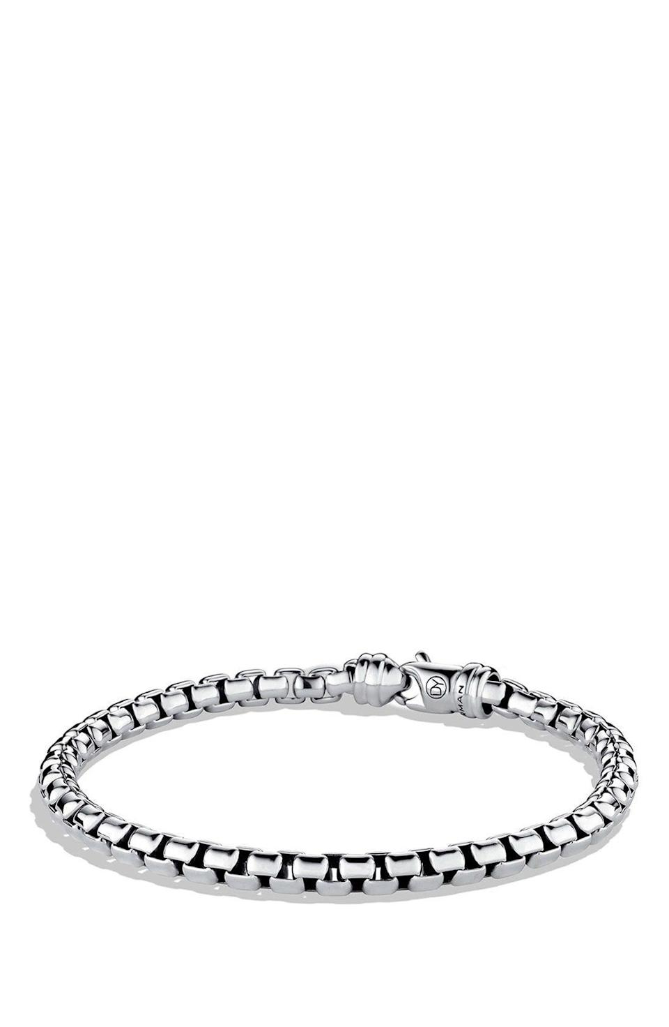 "<p><strong>David Yurman</strong></p><p>nordstrom.com</p><p><strong>$325.00</strong></p><p><a href=""https://go.redirectingat.com?id=74968X1596630&url=https%3A%2F%2Fshop.nordstrom.com%2Fs%2Fdavid-yurman-chain-large-link-box-chain-bracelet%2F3854595&sref=https%3A%2F%2Fwww.harpersbazaar.com%2Ffashion%2Ftrends%2Fg4473%2Fmens-holiday-gift-guide%2F"" rel=""nofollow noopener"" target=""_blank"" data-ylk=""slk:SHOP NOW"" class=""link rapid-noclick-resp"">SHOP NOW</a></p><p>Sleek, simple, and timeless, this wrist piece is a wardrobe essential. </p>"