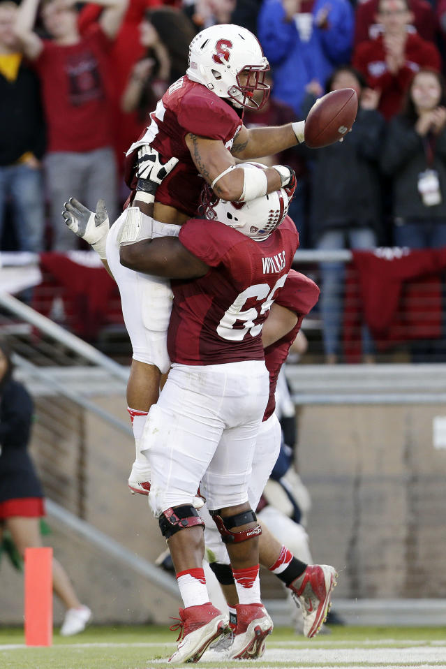 Stanford running back Tyler Gaffney, top, celebrates his rushing touchdown with teammate Khalil Wilkes (65) during the second half of an NCAA college football game against Arizona State on Saturday, Sept. 21, 2013, in Stanford, Calif. Stanford won 42-28. (AP Photo/Marcio Jose Sanchez)