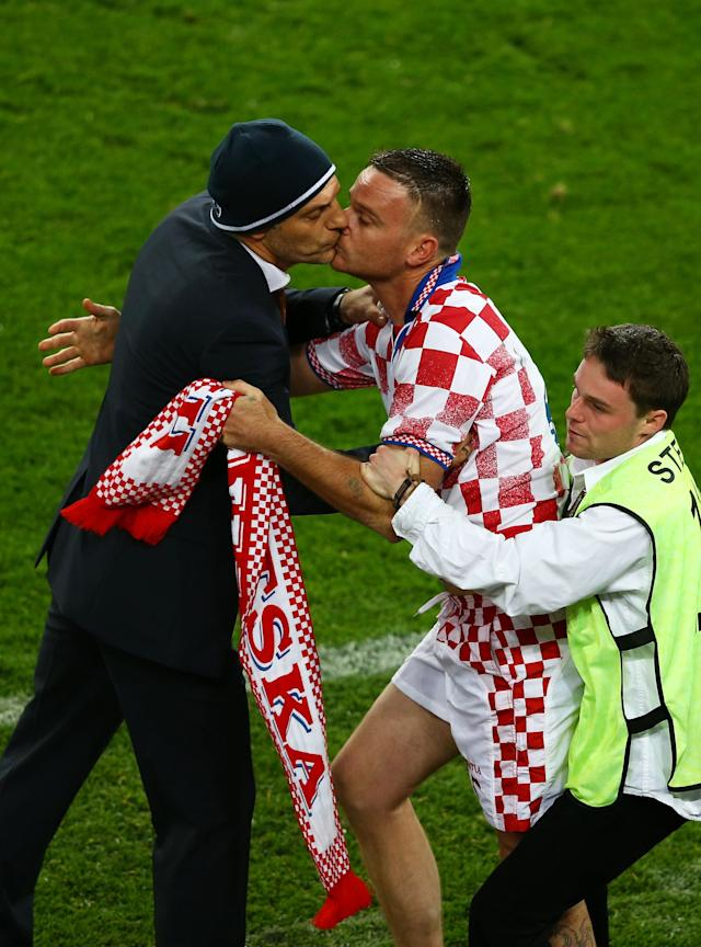 POZNAN, POLAND - JUNE 10: A steward restrains a pitch invader as he kisses to Head Coach Slaven Bilic of Croatia during the UEFA EURO 2012 group C between Ireland and Croatia at The Municipal Stadium on June 10, 2012 in Poznan, Poland. (Photo by Clive Mason/Getty Images)