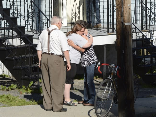 Lac-Megantic residents hug after being allowed to return to their homes Thursday, July 11, 2013 near the scene of a train derailment. THE CANADIAN PRESS/Ryan Remiorz
