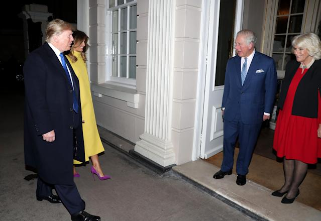 First Lady Melania Trump and US President Donald Trump are greeted by Prince Charles, Prince of Wales and Camilla, Duchess of Cornwall as they attend Tea at Clarence House on 3 December 2019. [Photo: Getty]