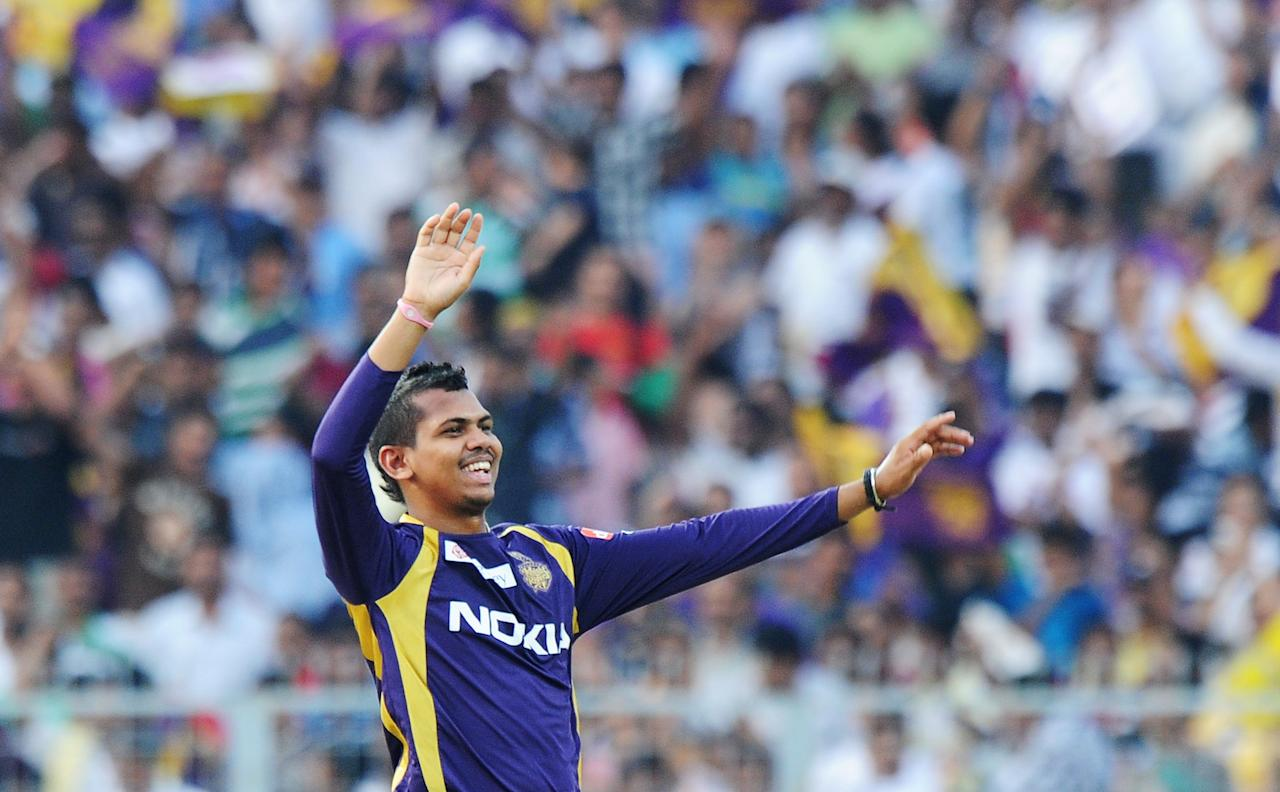 Kolkata Knight Riders bowler Sunil Narine celebrates after taking the wicket of Kings XI Punjab batsman Praveen Kumar (unseen) during the IPL Twenty20 cricket match between Kolkata Knight Riders and Kings XI Punjab at The Eden Gardens in Kolkata on April 15, 2012. RESTRICTED TO EDITORIAL USE. MOBILE USE WITHIN NEWS PACKAGE. AFP PHOTO/Dibyangshu SARKAR (Photo credit should read DIBYANGSHU SARKAR/AFP/Getty Images)