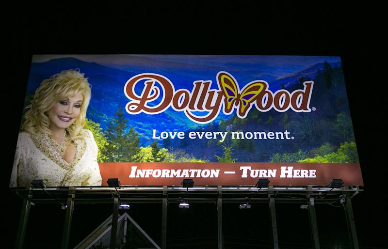 PIGEON FORGE, TN - OCTOBER 18: A billboard on The Parkway promotes Dolly Parton's Dollywood as viewed on October 18, 2016 in Pigeon Forge, Tennessee. Located near the entrance to Great Smoky Mountains National Park, this tourist resort community is home to Dollywood and other entertainment and roadside attractions. (Photo by George Rose/Getty Images)