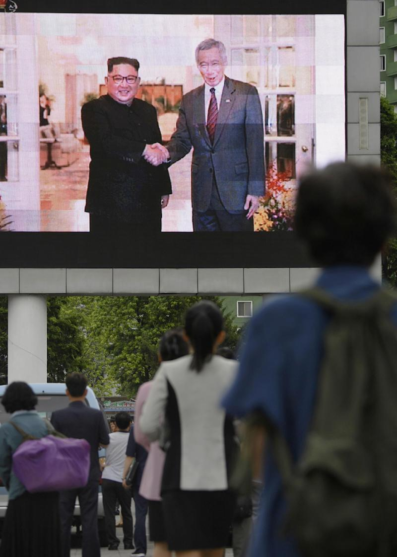 North Koreans watch a news report on North Korean leader Kim Jong Un's visit to Singapore in Pyongyang, North Korea, on June 11, 2018. (Kyodo/via Reuters)