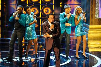 "Motown legend Smokey Robinson joined Afro-Blue on the ""Sing-Off"" stage (Lewis Jacobs/NBC)"