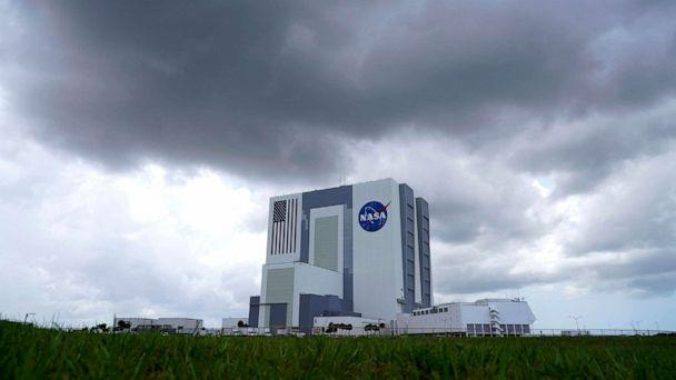 PHOTO: Storm clouds pass over the Vehicle Assembly Building as a SpaceX Falcon 9, with NASA astronauts Doug Hurley and Bob Behnken in the Crew Dragon capsule, sits on Launch Pad 39-A at the Kennedy Space Center in Cape Canaveral, Fla., May 30, 2020. (David J. Phillip/AP)