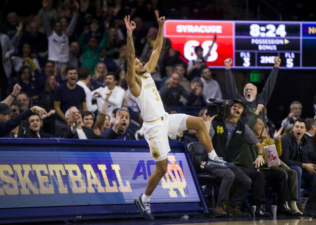 Notre Dame's Rex Pflueger (0) celebrates a 3-pointer during the second half of an NCAA college basketball game against Syracuse on Wednesday, Jan. 22, 2020, in South Bend, Ind. Syracuse won 84-82. (AP Photo/Robert Franklin)