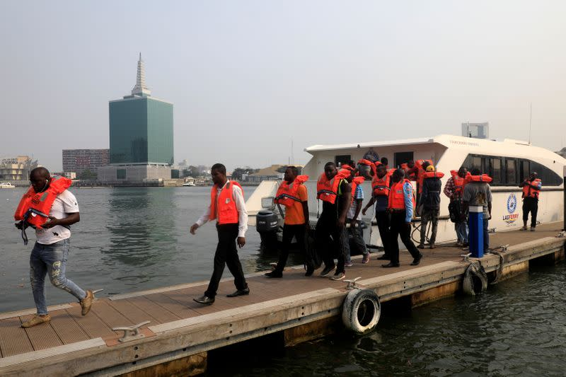 Passengers alight from a boat after arriving at Five Cowries Terminal in Falomo Lagos