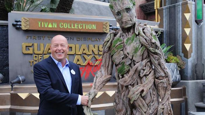 Bob Chapek (left) and Groot (right)