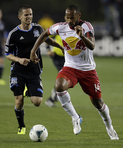 New York Red Bulls' Thierry Henry (14) and San Jose Earthquakes' Sam Cronin, left, chase down the ball during the first half of an MLS soccer game Sunday, March 10, 2013, in Santa Clara, Calif. (AP Photo/Ben Margot)