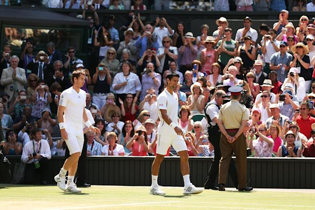 LONDON, ENGLAND - JULY 07: Andy Murray of Great Britain and Novak Djokovic of Serbia walk out on to Centre Court for their Gentlemen's Singles Final match on day thirteen of the Wimbledon Lawn Tennis Championships at the All England Lawn Tennis and Croquet Club on July 7, 2013 in London, England. (Photo by Clive Brunskill/Getty Images)