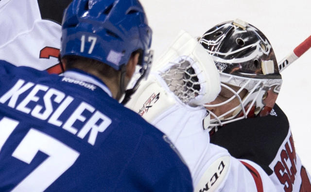 New Jersey Devils goalie Cory Schneider, right, gloves a shot from Vancouver Canucks center Ryan Kesler (17) during the second period of an NHL hockey game Tuesday, Oct. 8, 2013, in Vancouver, British Columbia. (AP Photo/The Canadian Press, Jonathan Hayward)