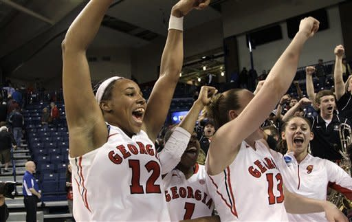 Georgia's Jasmine Hassell (12) and teammates cheer after beating Iowa State in a second-round game in the women's NCAA college basketball tournament in Spokane, Wash., Monday, March 25, 2013. Georgia won 65-60. (AP Photo/Elaine Thompson)