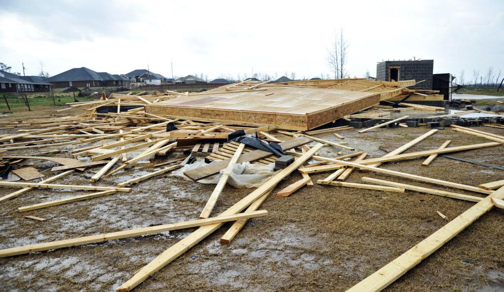 A home under construction after being leveled during an April 2011 tornado, lies damaged again, Friday, March 2, 2012 in Harvest, Ala., after another reported tornado. (AP Photo/The Huntsville Times, Bob Gathany)