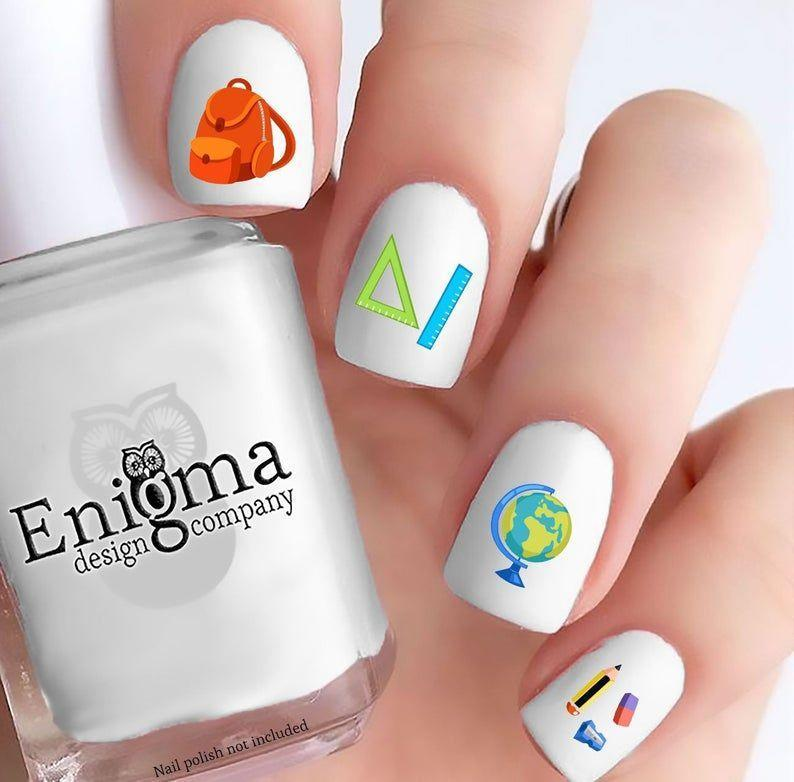 """<p><strong>EnigmaDesignCompany</strong></p><p>etsy.com</p><p><strong>$4.75</strong></p><p><a href=""""https://go.redirectingat.com?id=74968X1596630&url=https%3A%2F%2Fwww.etsy.com%2Flisting%2F631051528%2Fback-to-school-accessories-vol-i&sref=https%3A%2F%2Fwww.goodhousekeeping.com%2Fbeauty%2Fnails%2Fg22590646%2Fback-to-school-nails%2F"""" rel=""""nofollow noopener"""" target=""""_blank"""" data-ylk=""""slk:Shop Now"""" class=""""link rapid-noclick-resp"""">Shop Now</a></p><p>If the thought of using dotting tools and tiny brushes is a bit intimidating, try these foolproof decals that highlight all of your classroom favorites, including No. 2 pencils, rulers, a globe, and backpack. </p><p><strong>RELATED: </strong><a href=""""https://www.goodhousekeeping.com/beauty/nails/g3546/what-your-nail-art-says-about-you/"""" rel=""""nofollow noopener"""" target=""""_blank"""" data-ylk=""""slk:What Your Favorite Nail Art Says About You"""" class=""""link rapid-noclick-resp"""">What Your Favorite Nail Art Says About You</a></p>"""