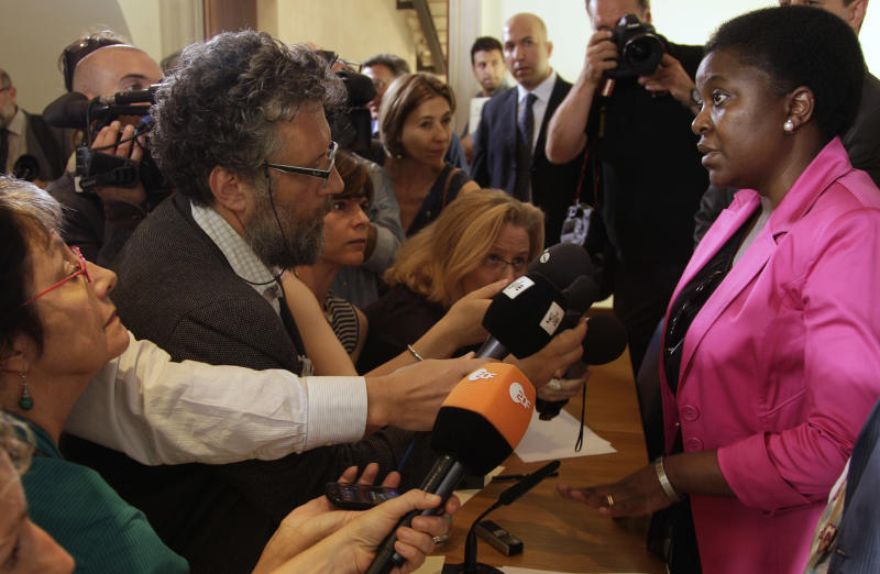"Italian Integration Minister Cecile Kashetu Kyenge listens to a question during a press conference at the Foreign Press Club in Rome, Wednesday, June 19, 2013. Kyenge on Wednesday acknowledged ""racist episodes"" in Italy but declined to brand the country as a whole racist. She has so far tempered her reaction to racist attacks, saying it's for Italians to respond, not her. (AP Photo/Domenico Stinellis)"