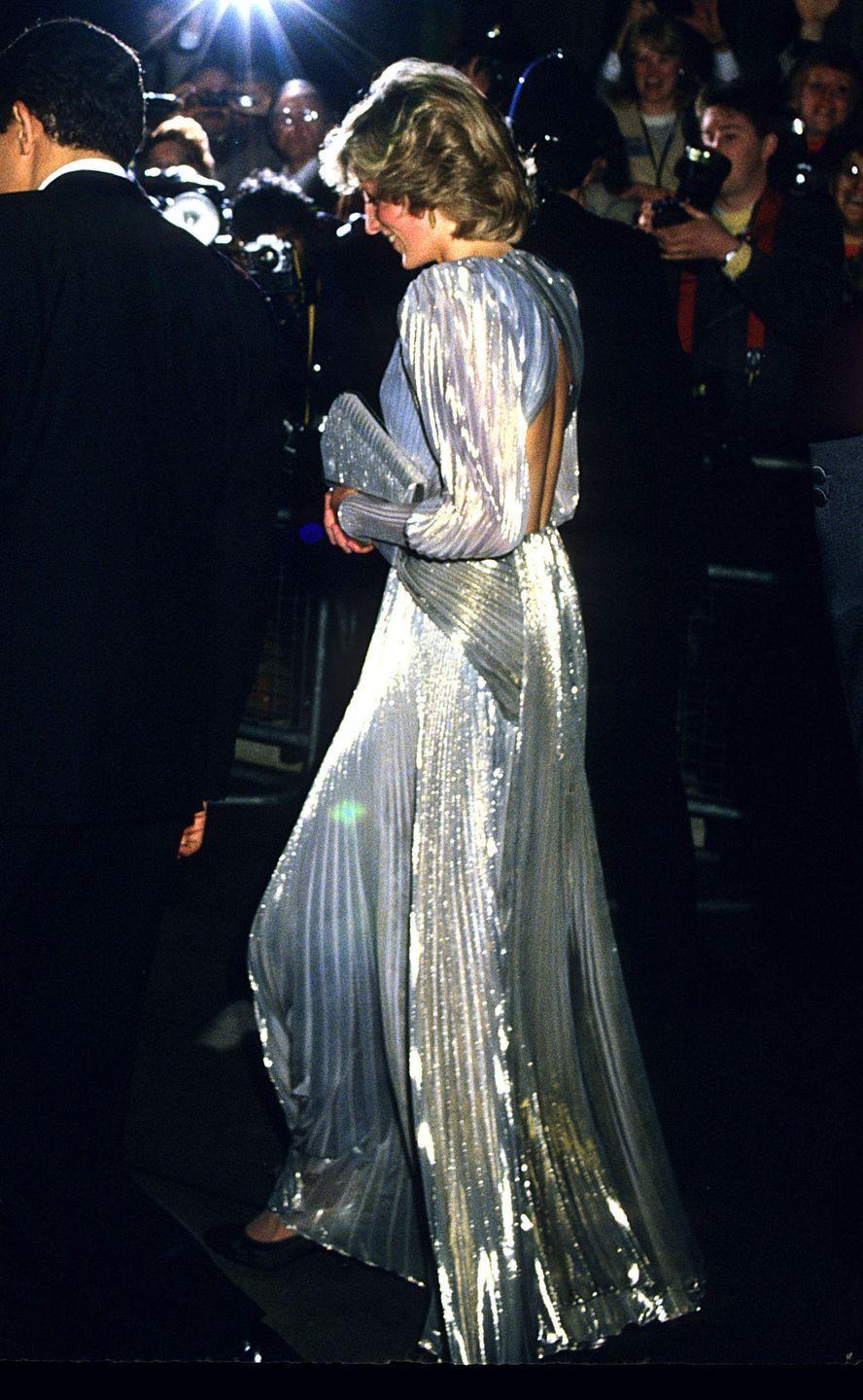 <p>For the premiere of <em>A View To a Kill</em>, Diana chose a long sleeved, metallic, backless gown, with a matching clutch. Prince Charles also attended the movie, rounding out the royal turnout. </p>
