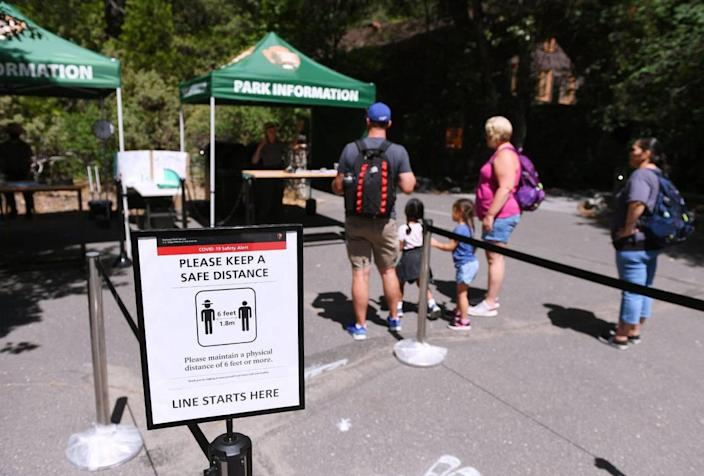 With the Visitor Center closed, informational booths are available for visitors as Yosemite National Park reopens after its historic closure Thursday morning, June 11, 2020.