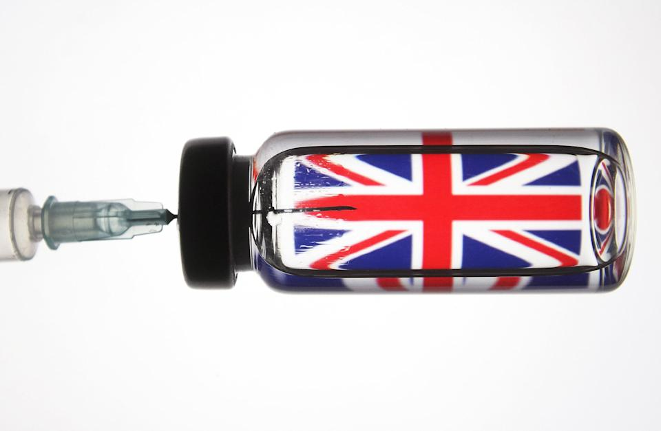 A medical syringe and a vial seen in front of the Union Jack (Photo: SIPA USA/PA Images)