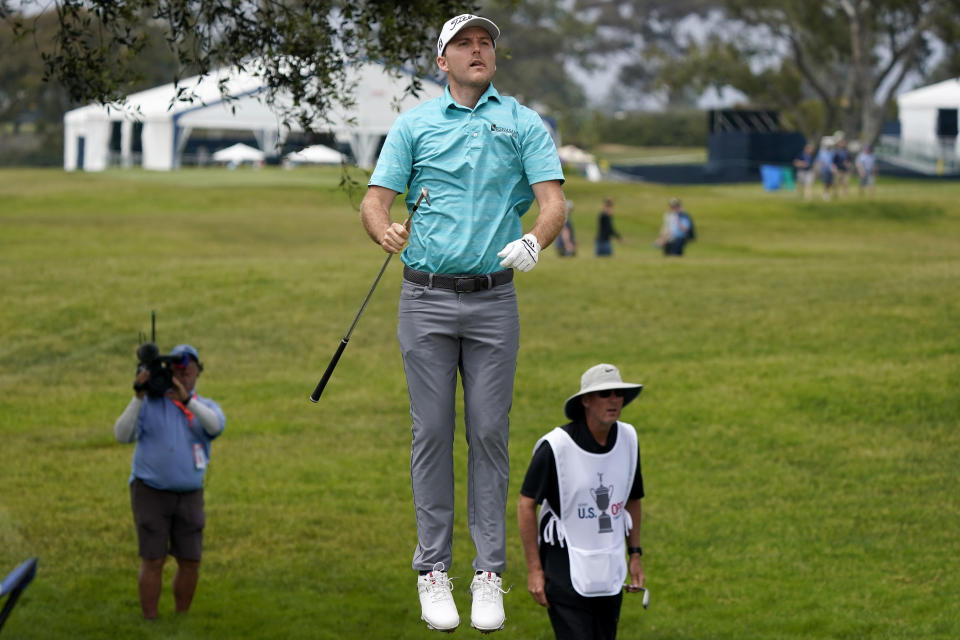 Russell Henley tries to line up his shot on the second fairway during the third round of the U.S. Open Golf Championship, Saturday, June 19, 2021, at Torrey Pines Golf Course in San Diego. (AP Photo/Marcio Jose Sanchez)