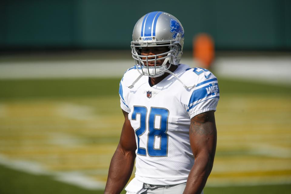 Detroit Lions' Adrian Peterson warms up before a game.