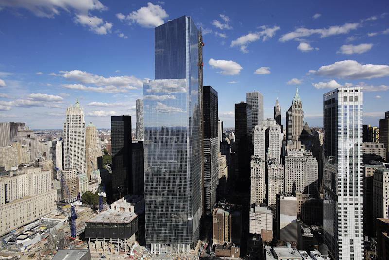 In this photo taken on Sept. 5, 2013, 4 World Trade Center, center, rises above the lower Manhattan skyline in New York. The 978-foot building designed by Pritzker Prize-winning architect Fumihiko Maki will open next Wednesday, Nov. 13. It is the first building to open at the site since the attacks of Sept. 11, 2001. (AP Photo/Mark Lennihan)