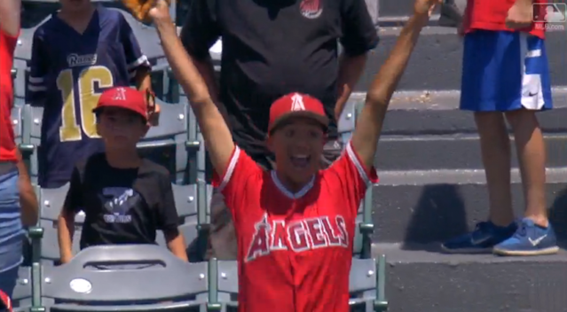 The Angels fan who caught Mike Trout's home run was really, really, really excited. (MLB.com)