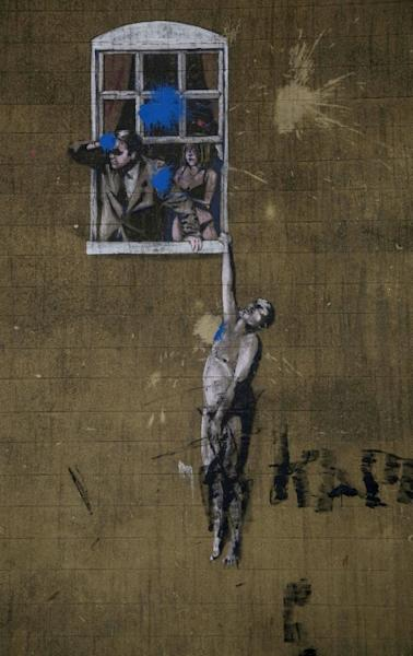 """Banksy's street art, titled """"Well Hung Lover"""" in Bristol, is another popular stop for tourists"""