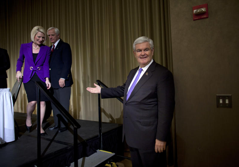 CORRECTS LOCATION-Republican presidential candidate, former House Speaker Newt Gingrich, right, waits for his wife, Callista, after speaking during the Ohio 5th Congressional District Lincoln-Reagan Day dinner at Bowling Green State University on Saturday, March 3, 2012 in Valdosta, Ga. Gingrich is staking his entire campaign on a big victory Tuesday in Georgia, where the onetime House speaker represented a suburban Atlanta district for 20 years. (AP Photo/Evan Vucci)