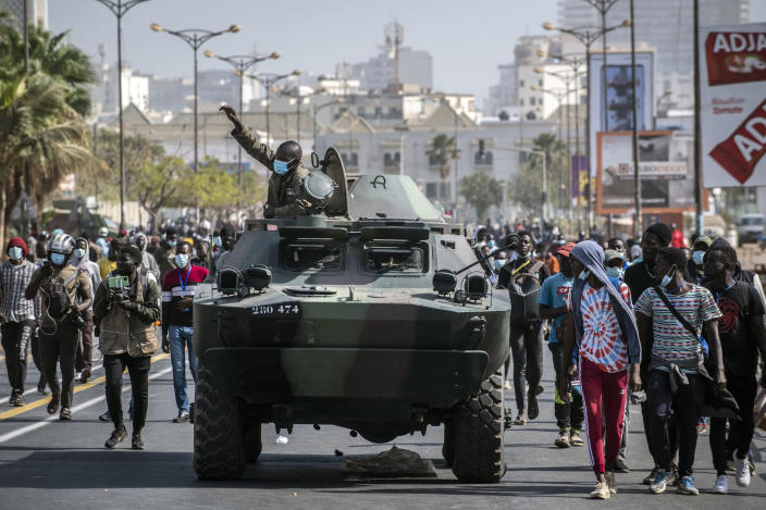 Senegalese troops arrive to assist police during protests against the arrest of opposition leader and former presidential candidate Ousmane Sonko in Dakar, Senegal, Friday, March 5, 2021. Days of violent protests in Senegal have killed at least one person, local reports say, as young people take to the streets nationwide in support of the main opposition leader who was detained Wednesday. (AP Photo/Sylvain Cherkaoui)