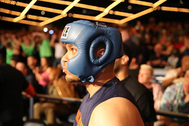 <p>Corrections officer Javier Colon awaits his introdcution before entering the ring during the NYPD Boxing Championships at the Theater at Madison Square Garden on June 8, 2017. (Photo: Gordon Donovan/Yahoo News) </p>