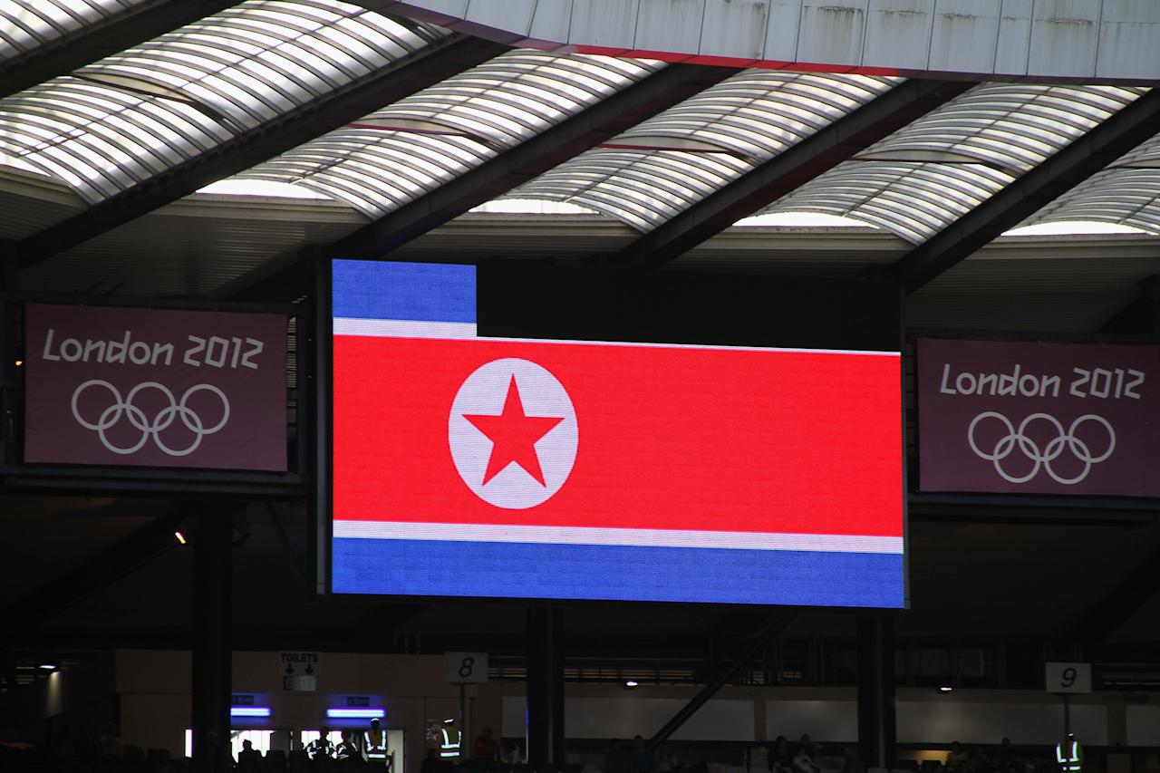 GLASGOW, SCOTLAND - JULY 25:  The national flag of the Democratic Peoples Republic of Korea is displayed on a large screen before the Women's Football first round Group G Match of the London 2012 Olympic Games between Colombia and Korea DPR, at Hampden Park on July 25, 2012 in Glasgow, Scotland.  (Photo by Stanley Chou/Getty Images)