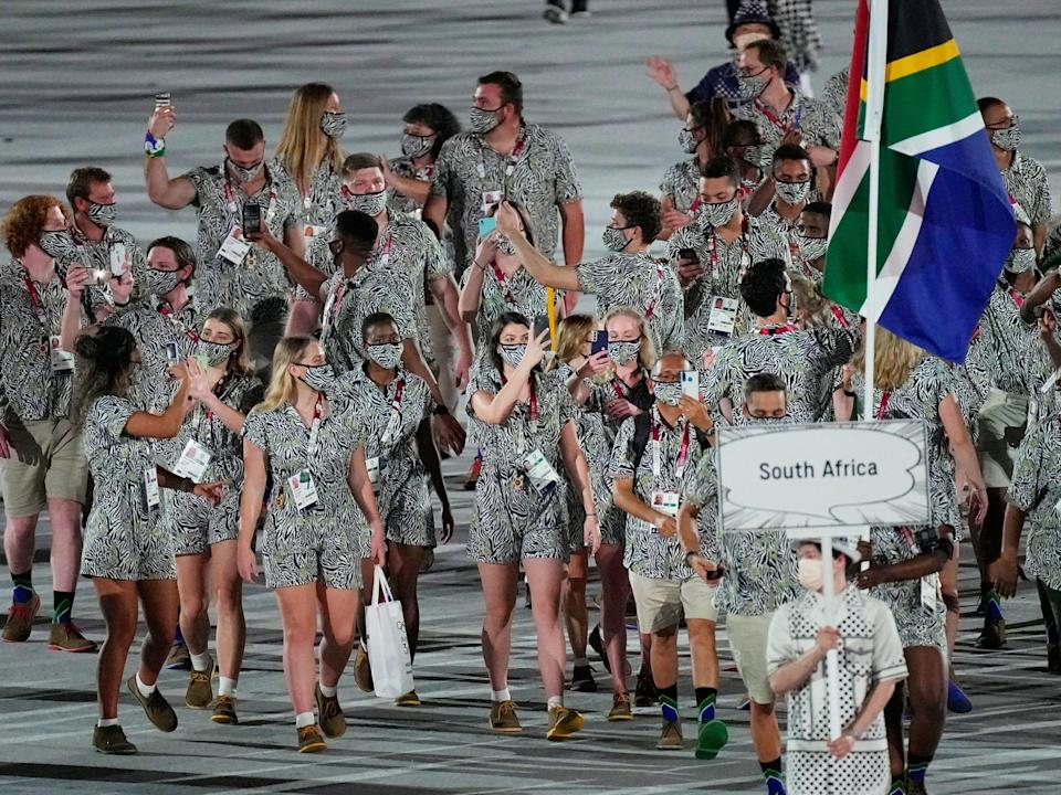 Athletes from South Africa make their entrance at the Summer Olympics.