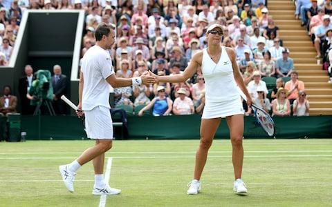 <span>Bruno Soares of Brazil (L) high fives Nicole Melichar of the United States</span> <span>Credit: GETTY IMAGES </span>
