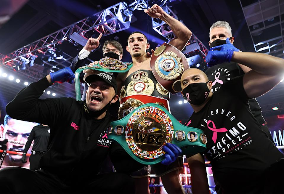 Teofimo Lopez celebrates with his team after beating Vasiliy Lomachenko (not pictured) via unanimous decision on Saturday at the MGM Grand Conference Center in Las Vegas. (Mikey Williams/Top Rank)