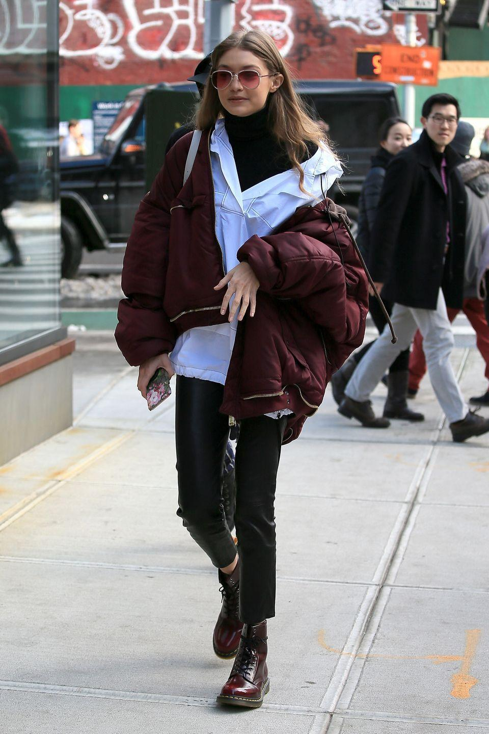 <p>Wearing off-the-shoulder coats is a fave celeb style trick. Gigi rocked the trend times two, with an oversized white top hanging off her shoulder, layered under a marshmallow coat that's also off-the-shoulder. </p>