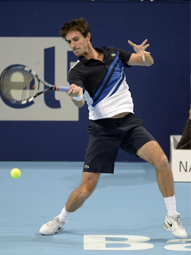 France's Edouard Roger-Vasselin returns a ball to Germany's Daniel Brands during their quarter final match at the Swiss Indoors tennis tournament at the St. Jakobshalle in Basel, Switzerland, on Friday, Oct. 25, 2013. (AP Photo/Keystone, Georgios Kefalas)