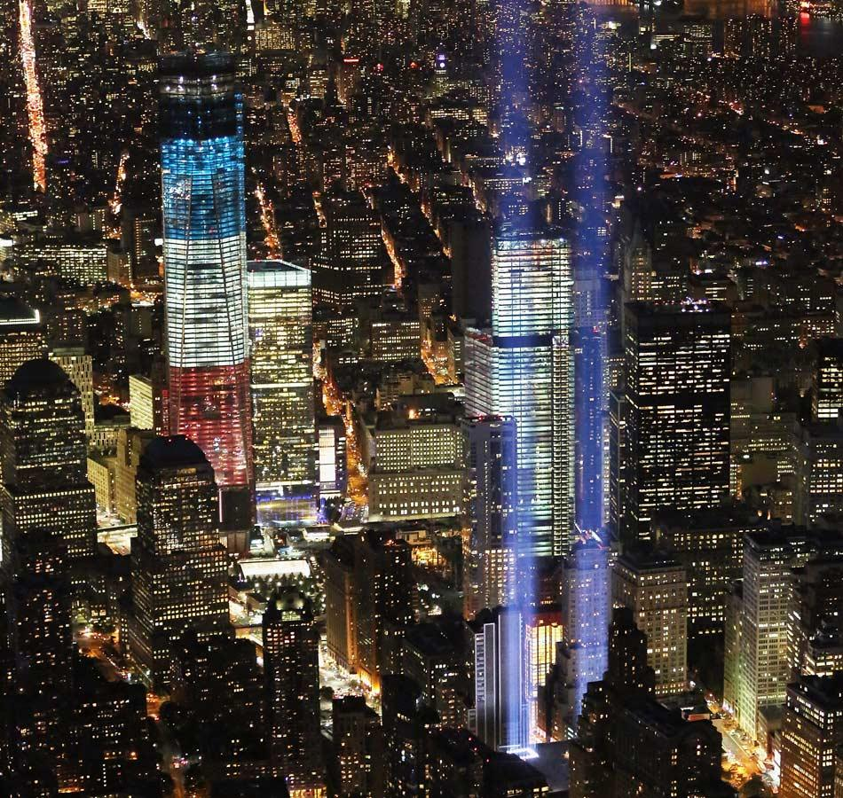 The 'Tribute in Light' shines as One World Trade Center (L) rises under construction on the eleventh anniversary of the terrorist attacks on lower Manhattan at the World Trade Center on September 11, 2012 in New York City. New York City and the nation are commemorating the eleventh anniversary of the September 11, 2001 attacks which resulted in the deaths of nearly 3,000 people after two hijacked planes crashed into the World Trade Center, one into the Pentagon in Arlington, Virginia and one crash landed in Shanksville, Pennsylvania.  (Photo by Mario Tama/Getty Images)