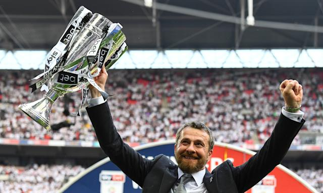 Fulham's manager, Slavisa Jokanovic, celebrates with the play-off trophy after his side saw off Aston Villa at Wembley on Saturday.