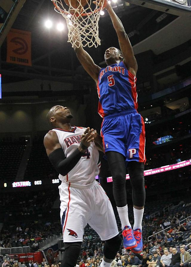 Detroit Pistons guard Kentavious Caldwell-Pope (5) slams against Atlanta Hawks forward Paul Millsap (4) in the second period of an NBA basketball game in Atlanta, Tuesday, April 8, 2014. (AP Photo/Todd Kirkland)