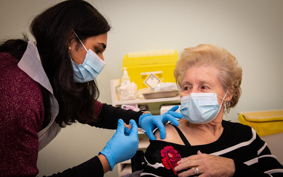Patricia Main, 75, gets the vaccine at Boots in Halifax - Will Johnston